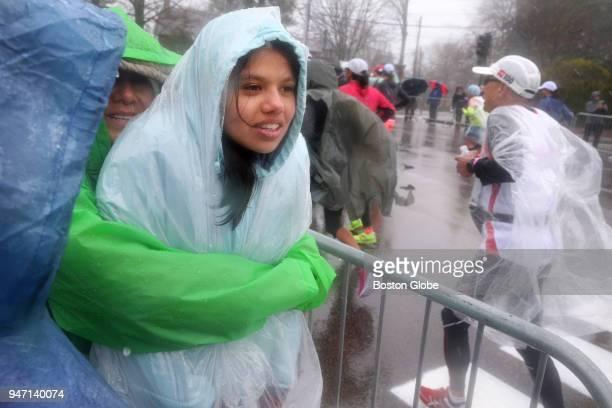 Spectators watch the race on Heartbreak Hill during the Boston Marathon in Newton Mass April 16 2018
