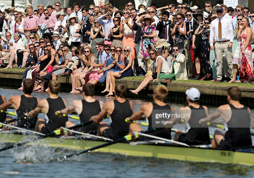 Spectators watch the racing on finals day of the Henley Royal Regatta on July 7, 2013 in Henley-on-Thames, England.