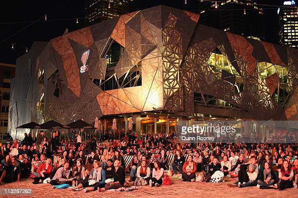 Spectators watch the Royal Wedding at Federation Square on April 29 2011 in Melbourne Australia Australians enjoyed the Royal Wedding of Prince...