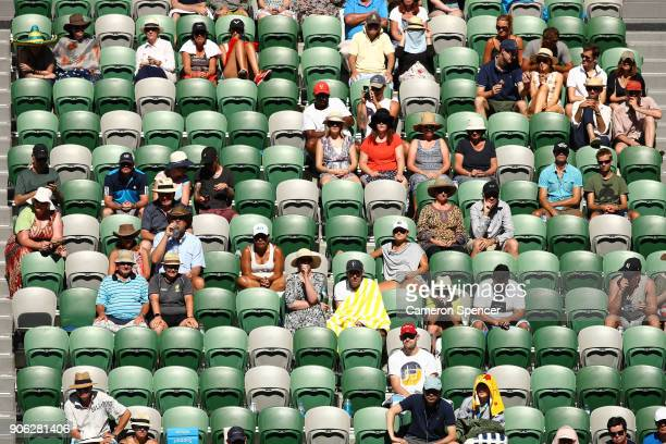 Spectators watch the second round match between Novak Djokovic of Serbia and Gael Monfils of France in hot weather on day four of the 2018 Australian...