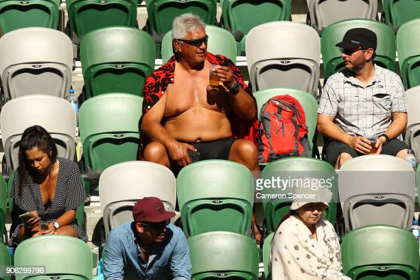 Spectators watch the second round match between Novak Djokovic of Serbia and Gael Monfils of France on day four of the 2018 Australian Open at...