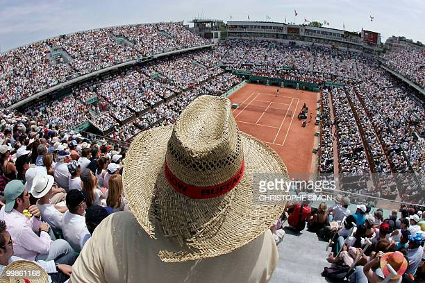 Spectators watch the start of the match opposing Swiss Roger Federer to Spain's Rafael Nadal during the French tennis Open finals at Roland Garros in...