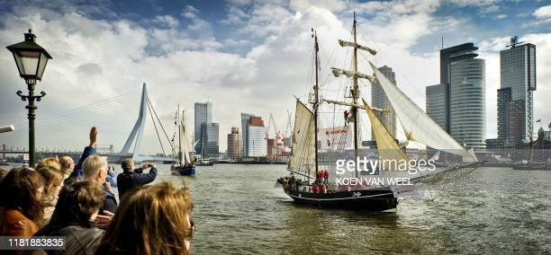 Spectators watch the start of the Race of the Classics in Rotterdam on April 4 2011 Seventeen tall ships depart from the harbor in Rotterdam and sail...