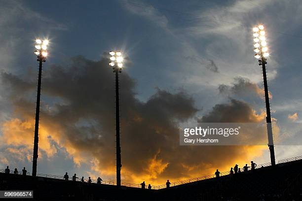 Spectators watch the sun set during the Kei Nishikori of Japan against Stan Wawrinka of Switzerland match at the US Open tennis championship in New...