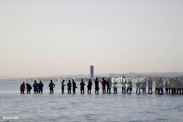 Spectators watch the swim leg of IRONMAN Italy Emilia Romagna on September 23 2017 in Cervia Italy