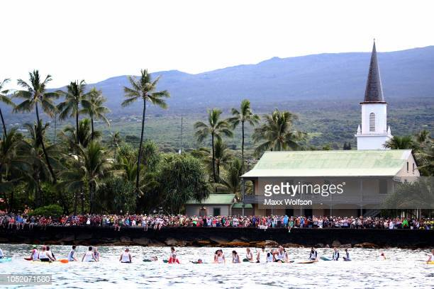 Spectators watch the swim portion of the IRONMAN World Championships brought to you by Amazon on October 13 2018 in Kailua Kona Hawaii