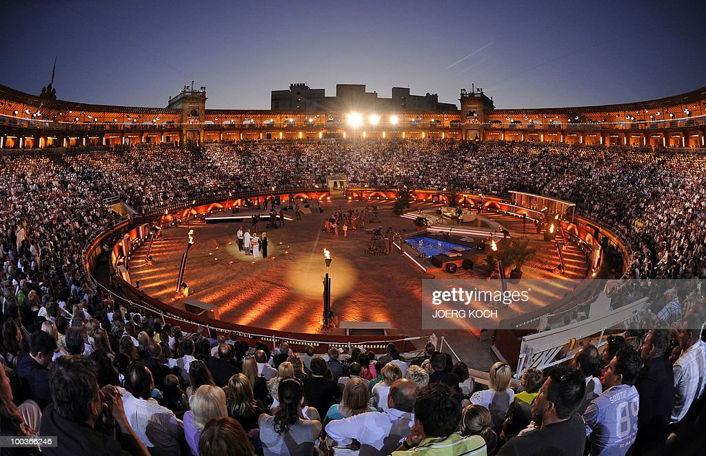 Spectators watch the television show 'Wetten, dass..?' (Let's Make a Bet) at the 'Coliseo Balear' bull fighting arena in Palma de Mallorca on the Balaeric Island of Mallorca on May 23, 2010.