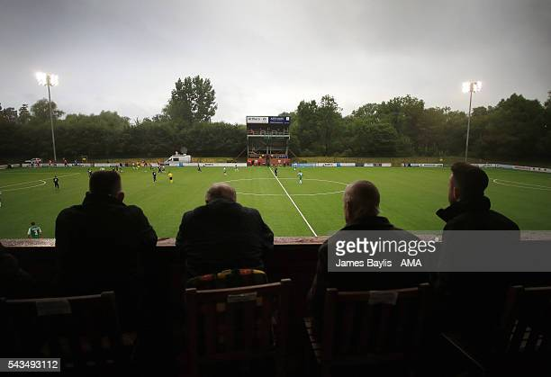 Spectators watch the UEFA Champions League First Round Qualifier match between The New Saints and SP Tre Penne at Park Hall on June 28 2016 in...