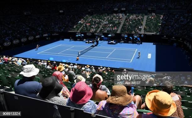 TOPSHOT Spectators watch the women's singles third round match between Ukraine's Elina Svitolina and Ukraine's Marta Kostyuk on day five of the...