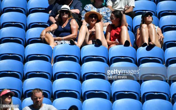 Spectators watch the women's singles third round match betwwen Czech Republic's Denisa Allertova and Poland's Magda Linette on day five of the...