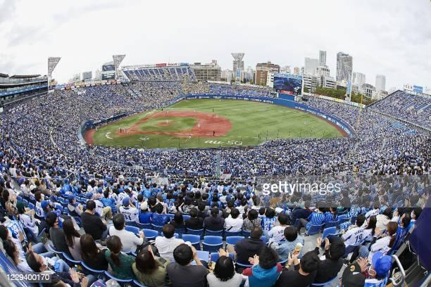 Spectators watch the Yokohama DeNA BayStars vs Hanshin TigersA beseball game at the Yokohama Stadium, the Olympic baseball and softball venue, in...