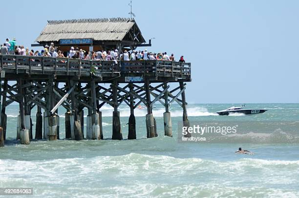 spectators watch watch offshore boat race from cocoa beach pier - cocoa beach stock pictures, royalty-free photos & images