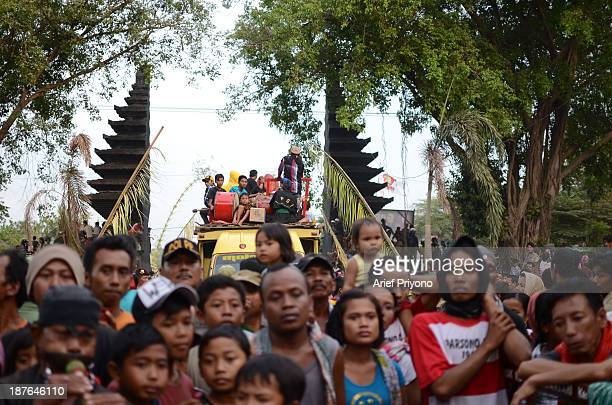 Spectators watching a traditional art performance known as Bantengan in Trowulan village Bantengan is a traditional Indonesian dance which originated...