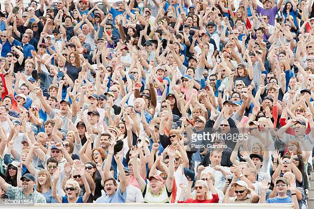 spectators watching car racing - crowd cheering stock pictures, royalty-free photos & images