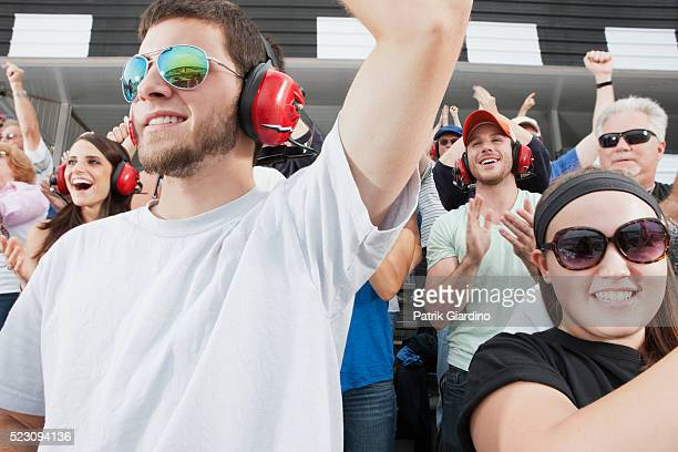 spectators watching car racing - motorsport stock pictures, royalty-free photos & images