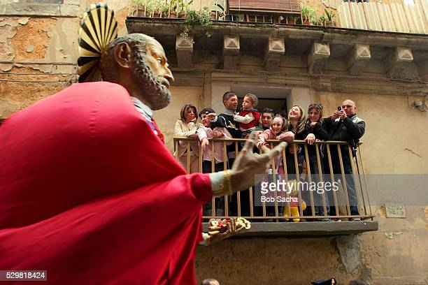 spectators watching easter procession in caltagirone - italian easter stock pictures, royalty-free photos & images