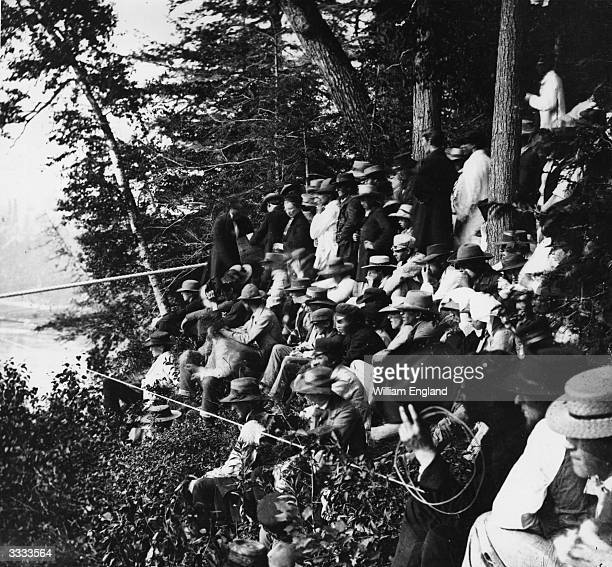 Spectators watching one of French acrobat Charles Blondin tightrope crossings of the Niagara gorge in the summer of 1859