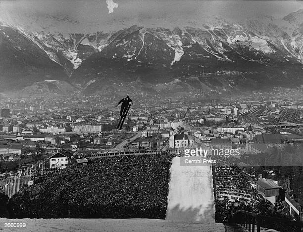 80000 spectators watching the skijump event at the Winter Olympic Games in Innsbruck