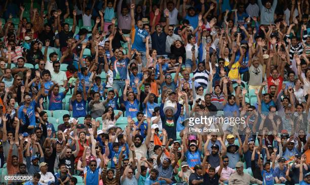Spectators wave during the ICC Champions Trophy Warmup match between India and New Zealand at the Kia Oval cricket ground on May 28 2017 in London...