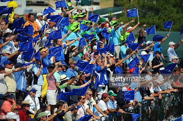 Spectators wave Europe flags in the stands surrounding the first tee during the singles matches on September 21 2008 during the 37th Ryder Cup at the...