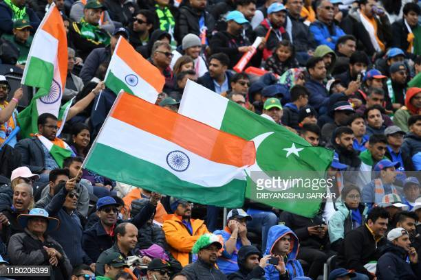 Spectators wave flags during the 2019 Cricket World Cup group stage match between India and Pakistan at Old Trafford in Manchester northwest England...
