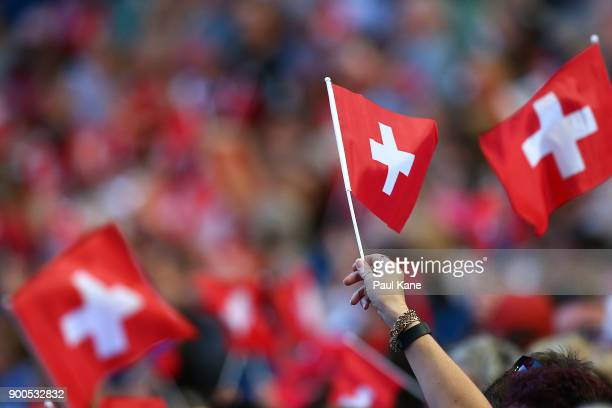 Spectators wave flags during the mens singles match between Roger Federer of Switzerland and Karen Khachanov of Russia on Day Four of the 2018 Hopman...