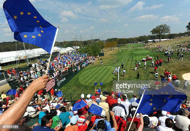 Spectators wave flags in the stands surrounding the first tee during the singles matches on September 21 2008 during the final day of the 37th Ryder...