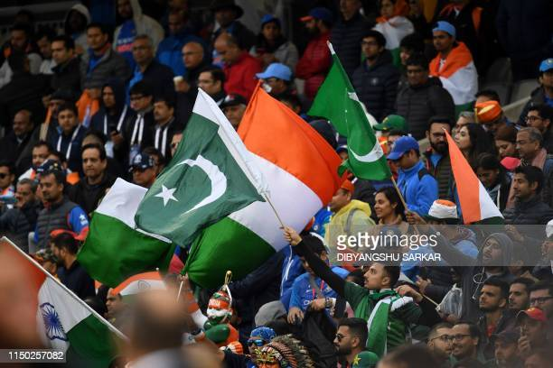 Spectators wave national flags after the 2019 Cricket World Cup group stage match between India and Pakistan at Old Trafford in Manchester northwest...