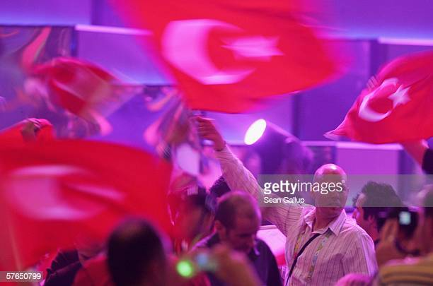 Spectators wave Turkish flags at the semifinals of the 2006 Eurovision Song Contest May 18 2006 in Athens Greece