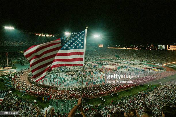 Spectators waving the Stars and Stripes flag of the United States during the Opening Ceremony of the XXVI Summer Olympic Games on 19 July 1996 at the...
