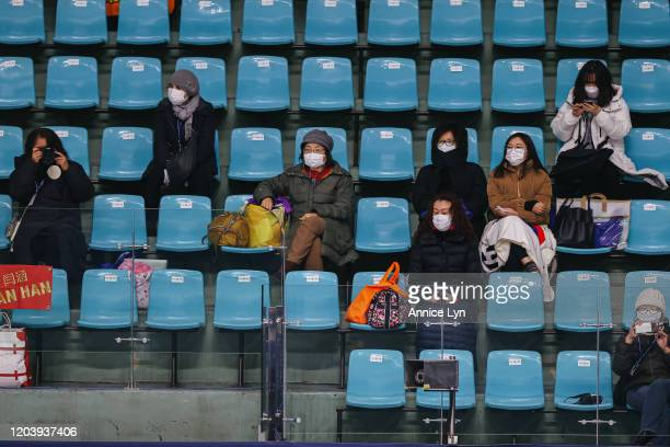 Spectators wear a face masks during the official practice of the ISU Four Continents Figure Skating Championships at Mokdong Ice Rink on February 04...