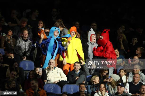 Spectators wear fancy dresses during the semi finals singles match between Novak Djokovic of Serbia and Kevin Anderson of South Africa during Day...