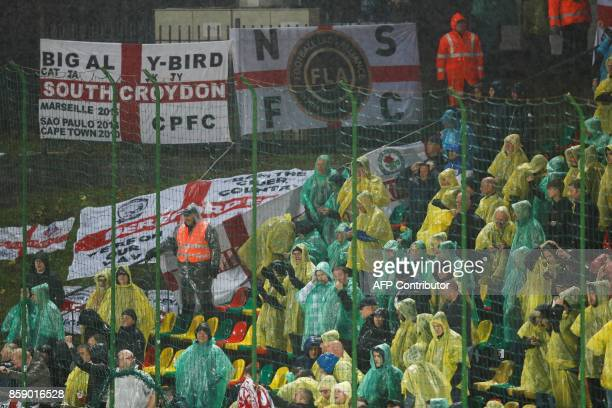 Spectators wear ponchos in the rain during the 2018 FIFA World Cup European Qualifying match between Lithuania and England at the LFF Stadium in...