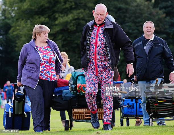 Spectators wear Union Flag clothing as they arrive for the start of the annual classical Proms Spectacular concert held on the north lawn of Castle...