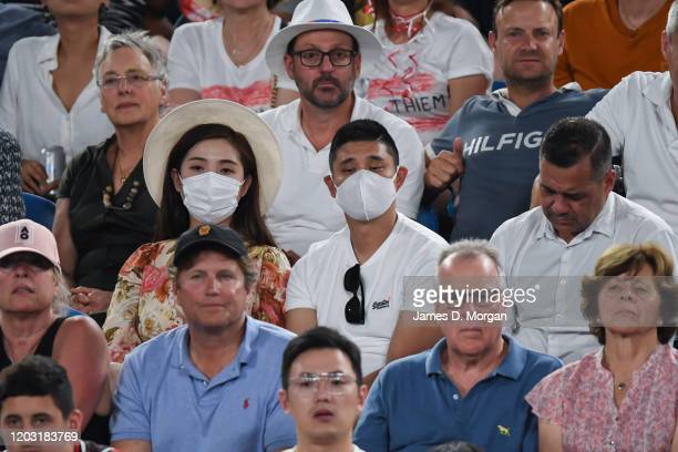 Spectators wearing face masks in light of the global coronavirus outbreak sitting on Rod Laver Arena during the men's semifinal between Alexander...