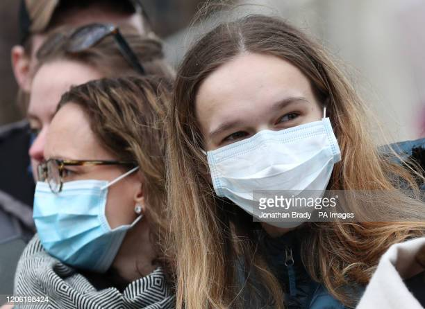 Spectators wearing masks to protect against coronavirus outside the Commonwealth Service at Westminster Abbey London on Commonwealth Day The service...