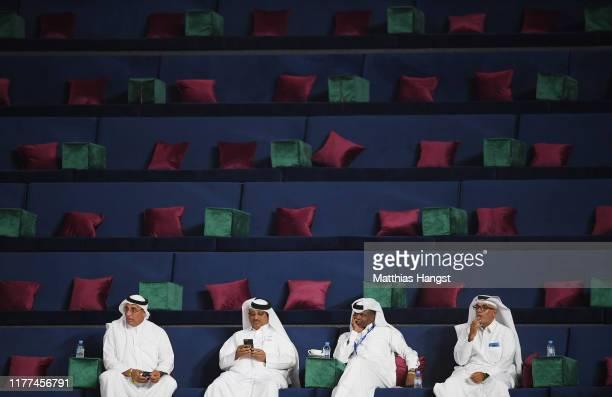 Spectators wearing thobes attend day one of 17th IAAF World Athletics Championships Doha 2019 at Khalifa International Stadium on September 27, 2019...