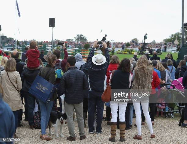 Spectators without tickets watch the riders in action during Day Four of The Land Rover Burghley Horse Trials 2017 on September 2 2017 in Stamford...