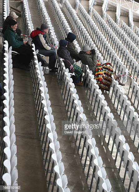 Spectators wrap up against the unseasonably cold weather to watch the LV County Championship division one match between Nottinghamshire and Middlesex...