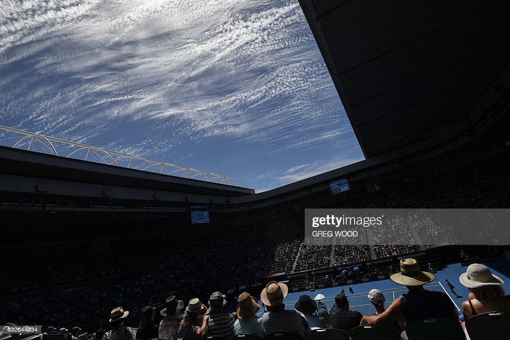 TOPSHOT - Spectatots watch the women's singles quarter-final match between Czech Republic's Karolina Pliskova (lower R) and Croatia's Mirjana Lucic-Baroni on day ten of the Australian Open tennis tournament in Melbourne on January 25, 2017. / AFP / GREG