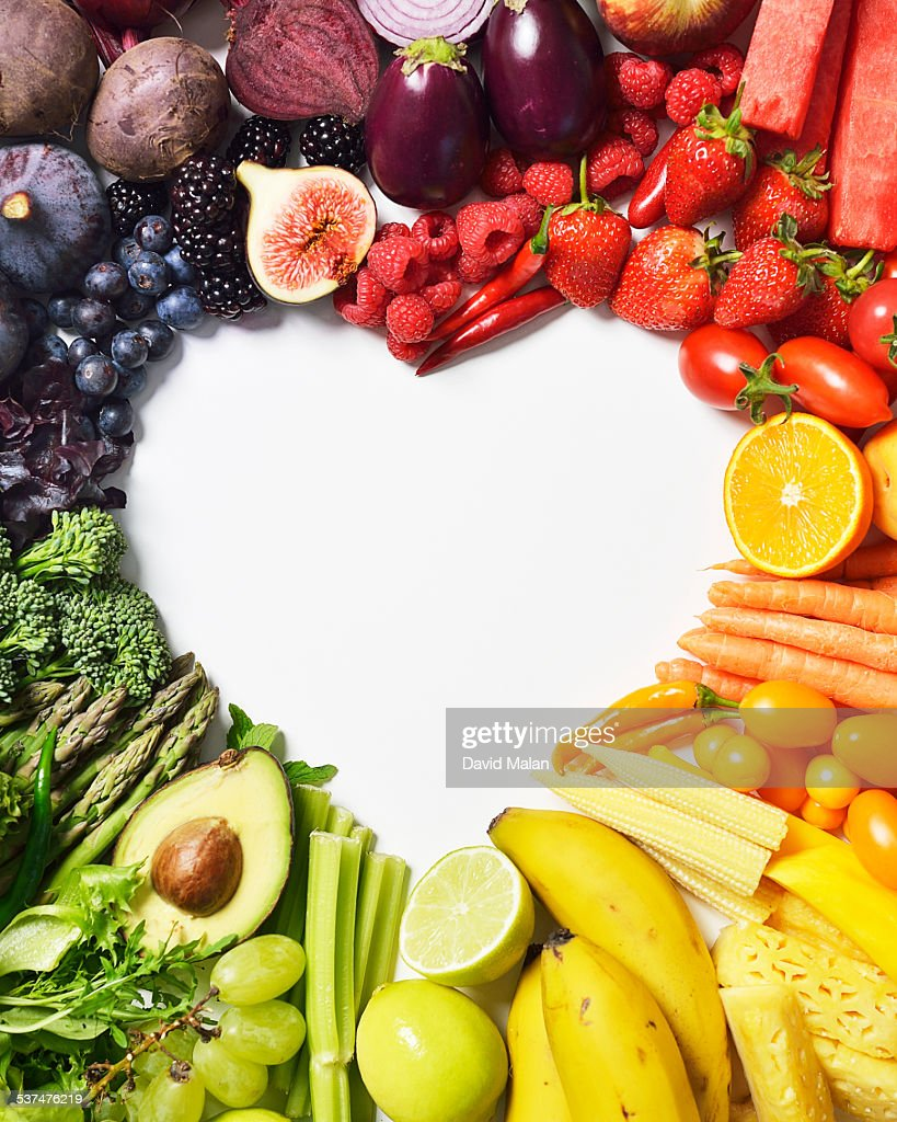 Spectrum of fruit & veg forming a heart shape : Stock Photo