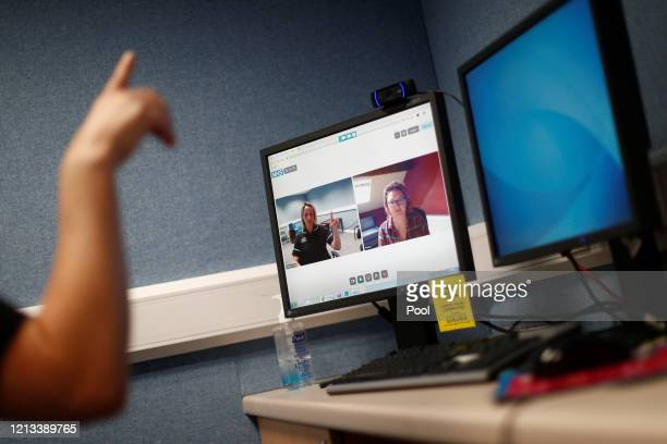 Speech and Language Therapist Alison McLoughlin conducts a therapy session with a patient using the Zoom app in the Ear, Nose and Throat department...