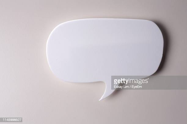 speech bubble against gray background - speech bubble stock pictures, royalty-free photos & images