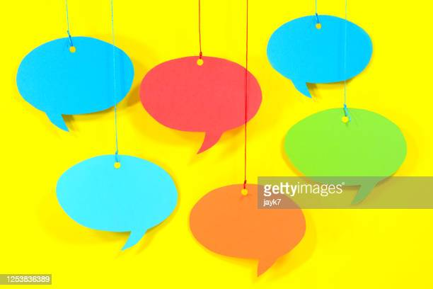 speech bubble - hanging stock pictures, royalty-free photos & images