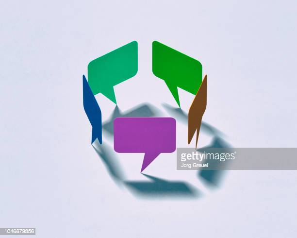speech bubbles forming a circle - community concept stock pictures, royalty-free photos & images