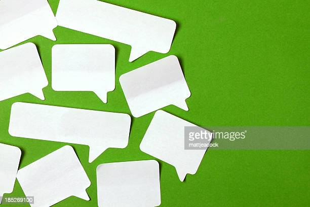 Speech bubbles on green