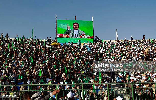 A speech by Shiite Huthi leader AbdulMalik alHouthi is screened as Yemeni Muslims including some Huthi supporters take part in a rally on the eve of...