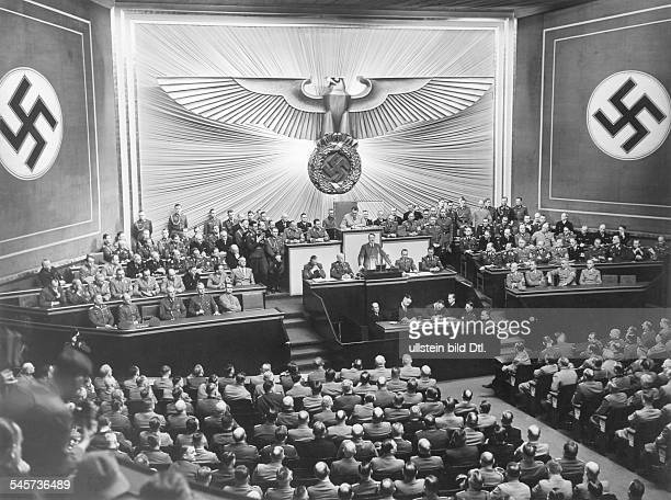 Speech held by Adolf Hitler at the Kroll opera House in Berlin the members of the Reichstag are listening on Hitler's right Otto DietrichAlbert...