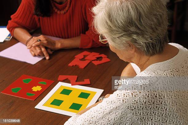 Speech Therapist And Patient At Home