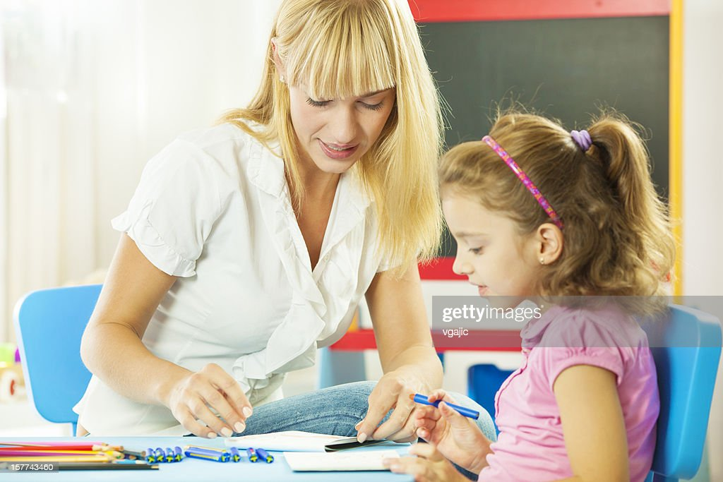 Speech Therapist Interacting with child : Stock Photo